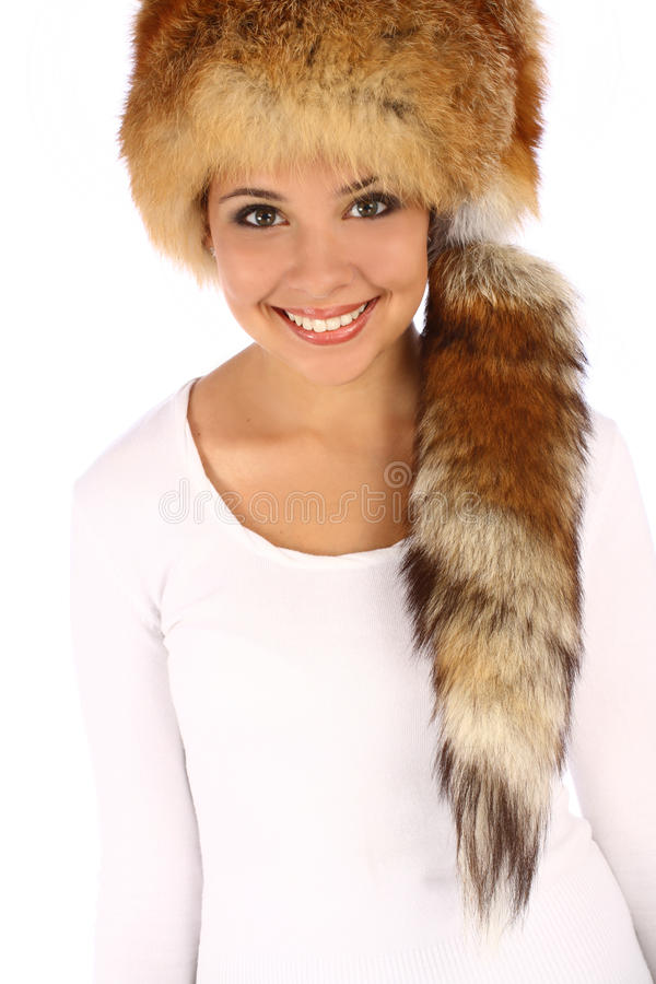 Attractive girl wearing fur hat isolated royalty free stock image