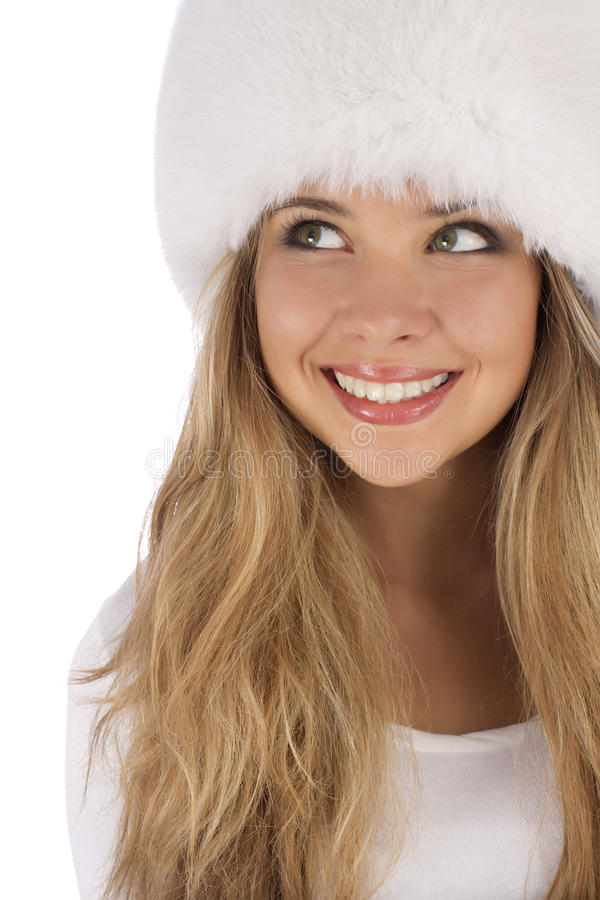 Attractive girl wearing white fur hat royalty free stock photos