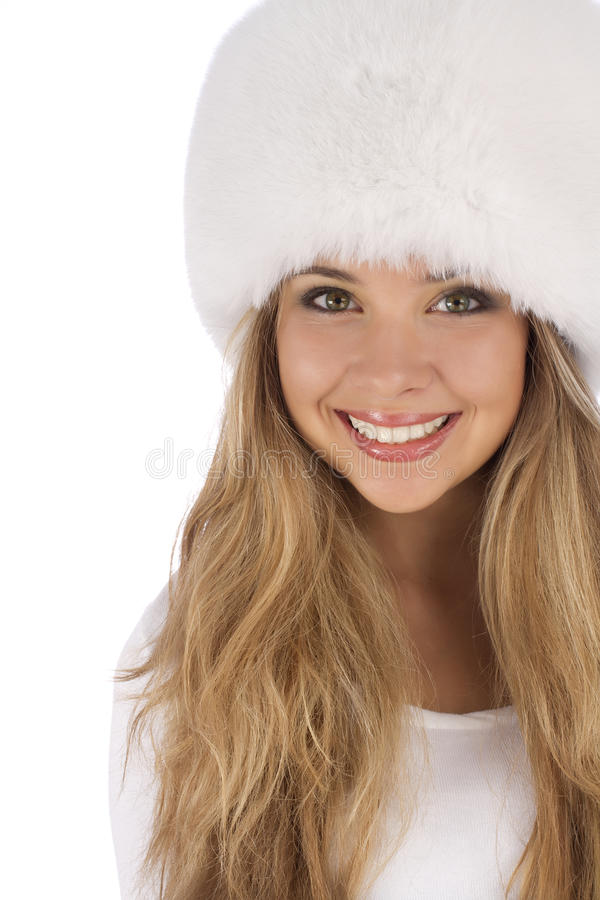 Attractive girl wearing white fur hat royalty free stock images