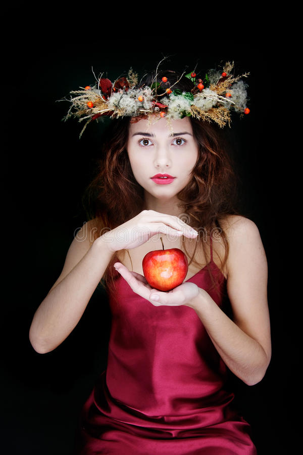 Free Attractive Girl With Apple Over Black Stock Images - 17104854
