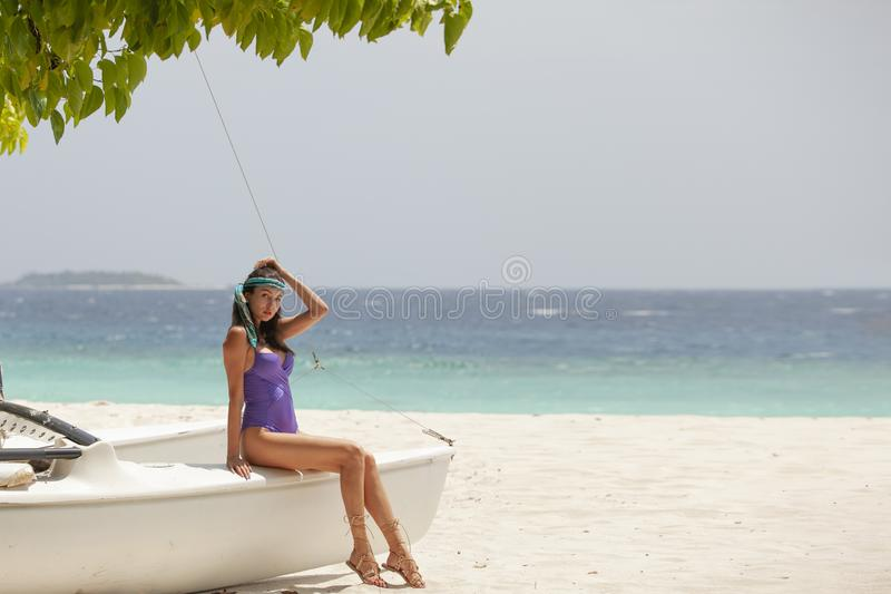 Attractive girl on a yacht during vacation royalty free stock photo