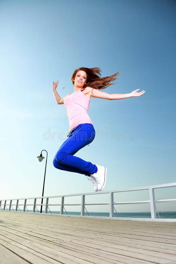Download Attractive Girl Young Woman Jumping Sky Stock Photo - Image: 28406796
