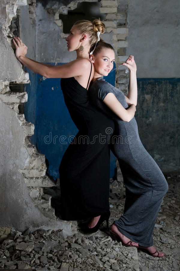 Download Attractive Girls In Dresses Posing In The Slums Stock Photo - Image: 14972948