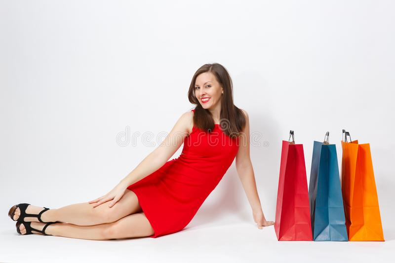 Attractive glamour caucasian fashionable young smiling woman in red dress isolated on white background. Copy space advertisement royalty free stock photography