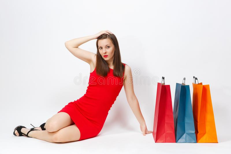 Attractive glamour caucasian fashionable young smiling woman in red dress isolated on white background. Copy space advertisement royalty free stock photos