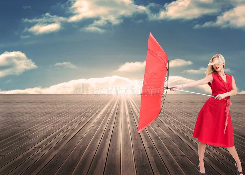 Attractive glamour woman holding a broken umbrella stock images