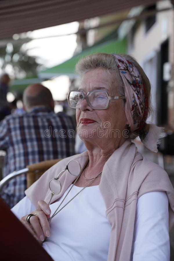 Attractive grandma in a restaurant. stock photos