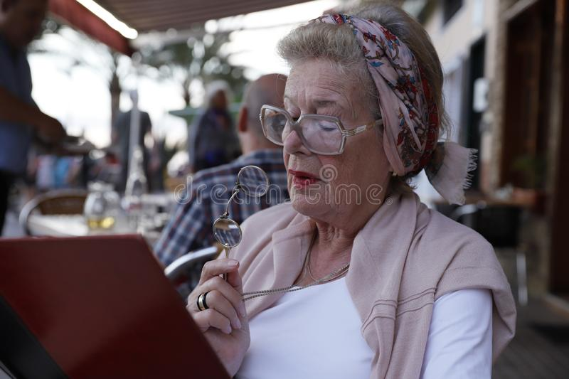Attractive grandma in a restaurant. royalty free stock photos