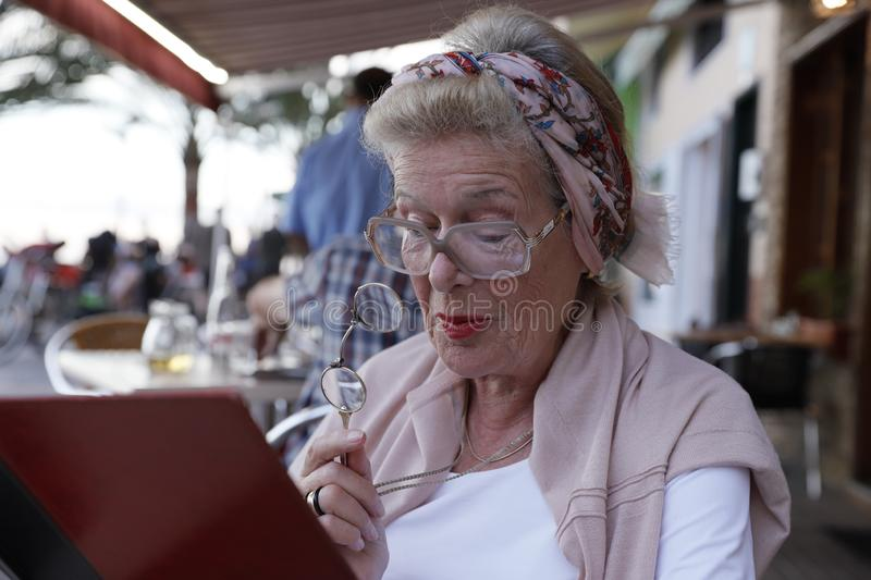 Attractive grandma in a restaurant. royalty free stock images