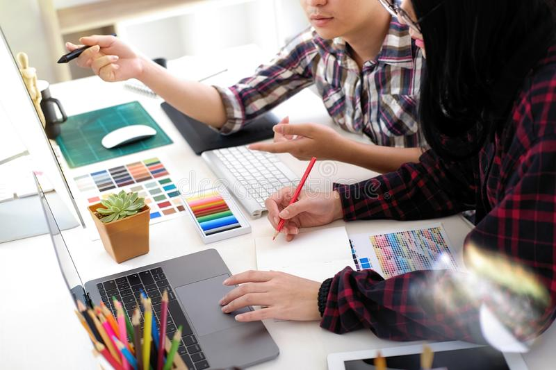 Graphic designer working in office. stock image