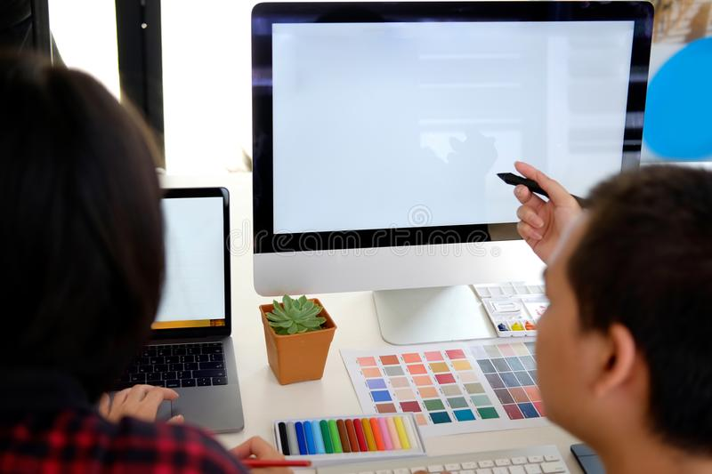 Graphic designer working in office. royalty free stock images