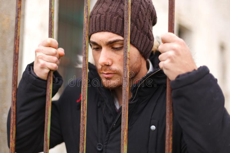 Attractive guy behide the bars royalty free stock photography