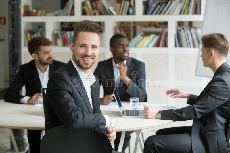 Attractive handsome businessman looking at camera and smiling. royalty free stock photo