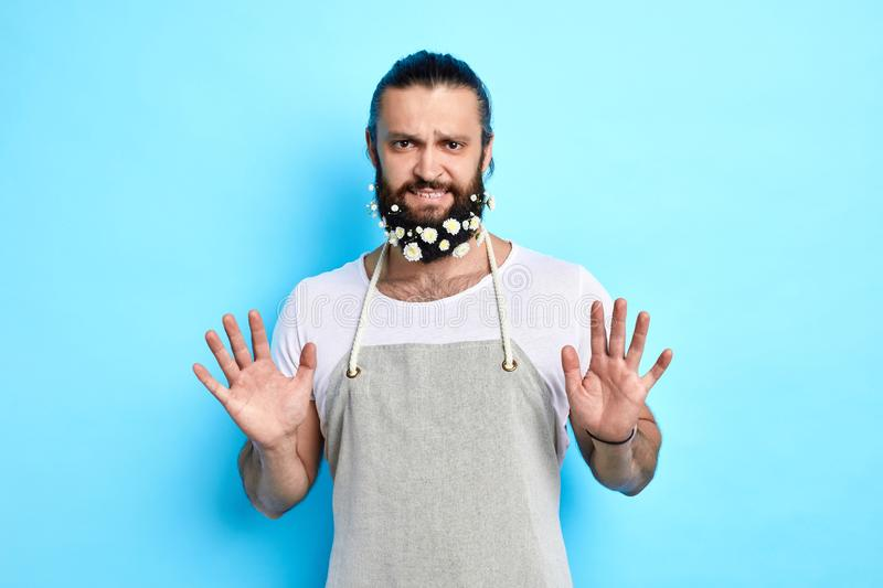 Attractive handsome man with opwn palms shows refusal gesture stock image