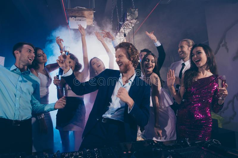 Attractive, handsome man in formal wear dance with glass of beve royalty free stock images