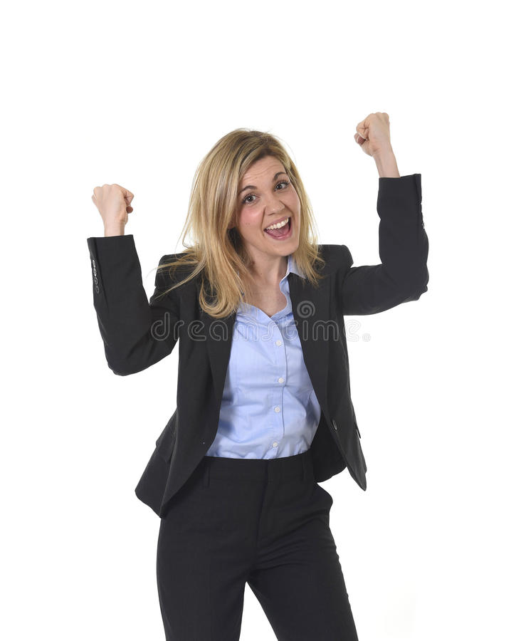 Attractive happy businesswoman posing gesturing with fist excited in business success. Corporate portrait of young attractive and happy business woman with long royalty free stock image