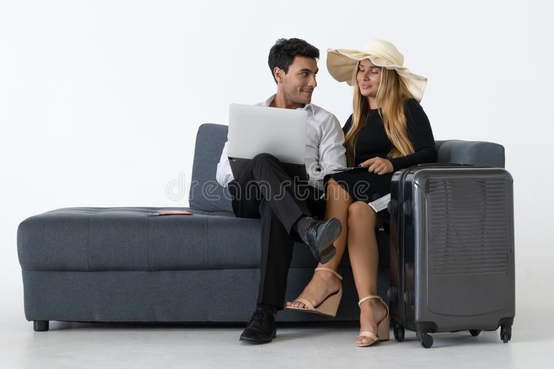Attractive happy couple sitting and planning vacations trip. Summer vacation concept stock photos
