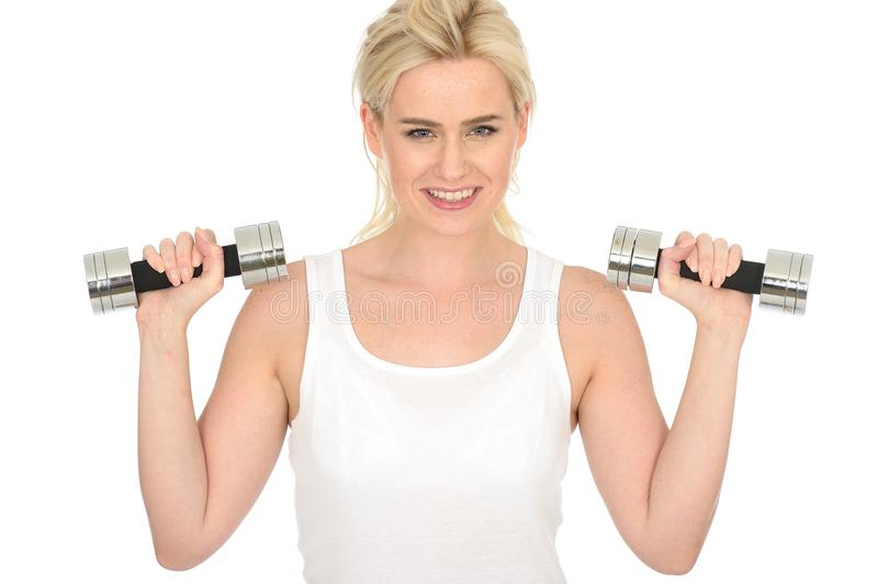 Attractive Happy Fit Healthy Young Blonde Woman Working Out with Dumb Bell Weights. Attractive happy Fit Healthy Young blonde Woman in Her Twenties, Working Out royalty free stock photography