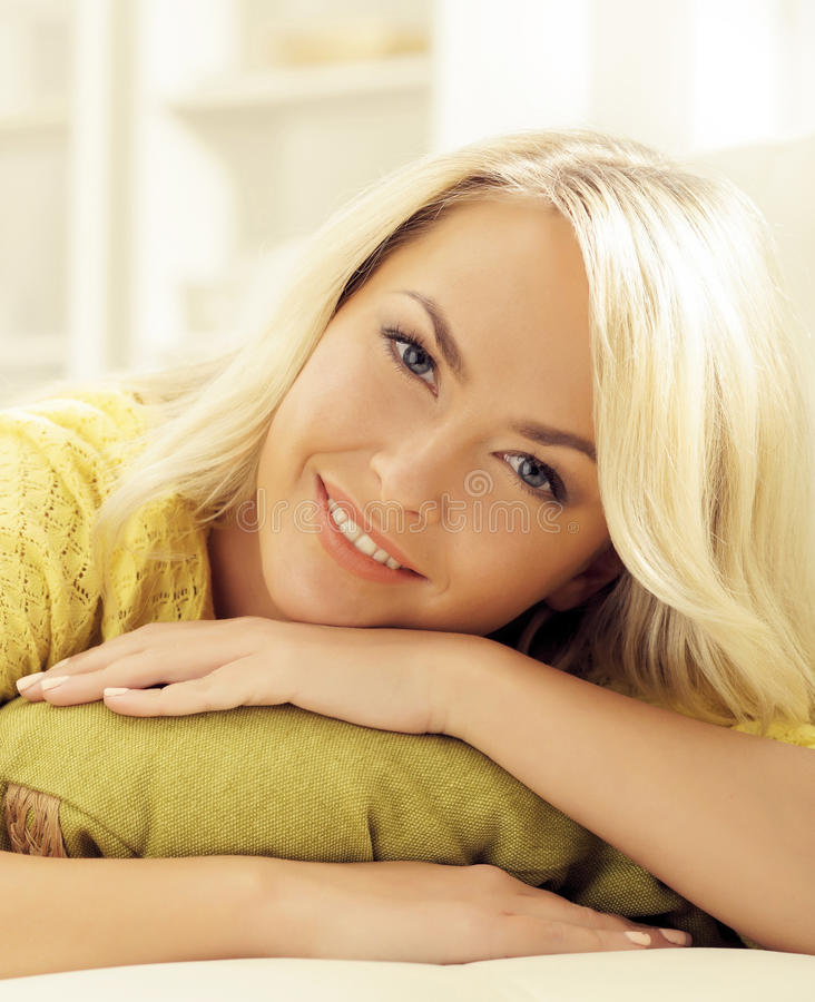 Attractive happy girl relaxing at home. Attractive beautiful happy girl relaxing at home stock image