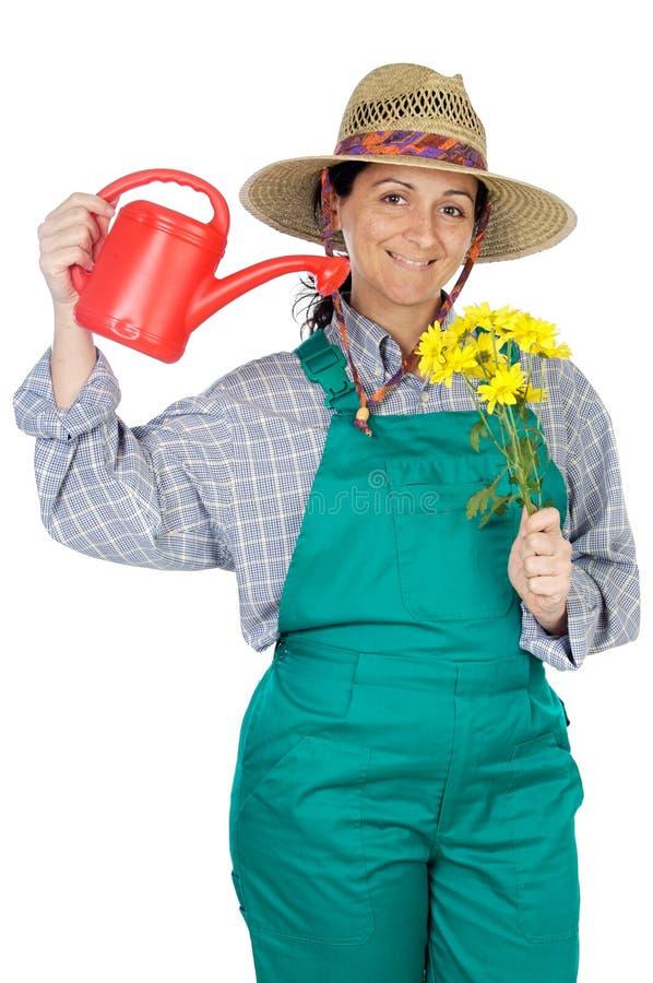 Attractive happy woman dressed gardener stock photos