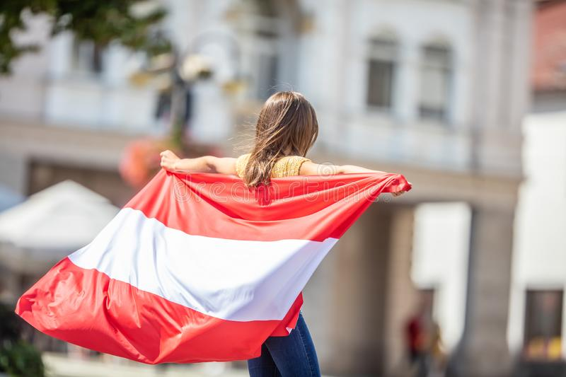 Attractive happy young girl with the Austria flag royalty free stock photography