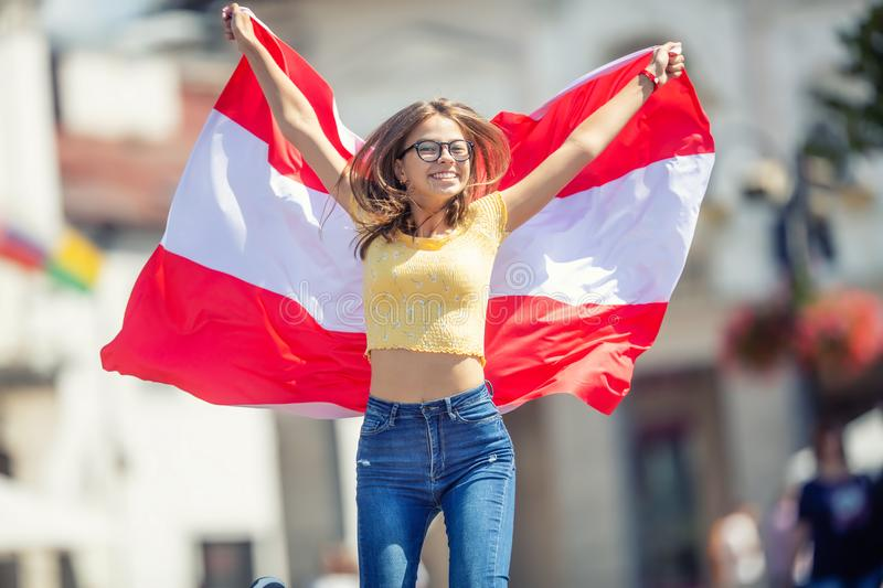 Attractive happy young girl with the Austria flag royalty free stock images