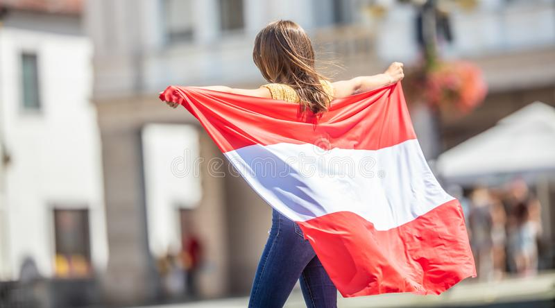 Attractive happy young girl with the Austria flag royalty free stock photos