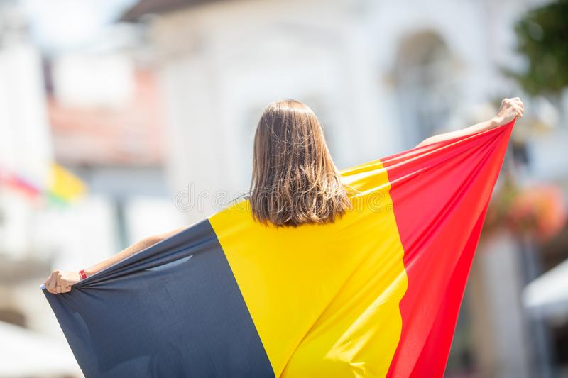 Attractive happy young girl with the Belgian flag royalty free stock photos
