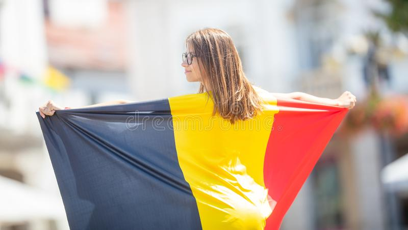 Attractive happy young girl with the Belgian flag royalty free stock photo