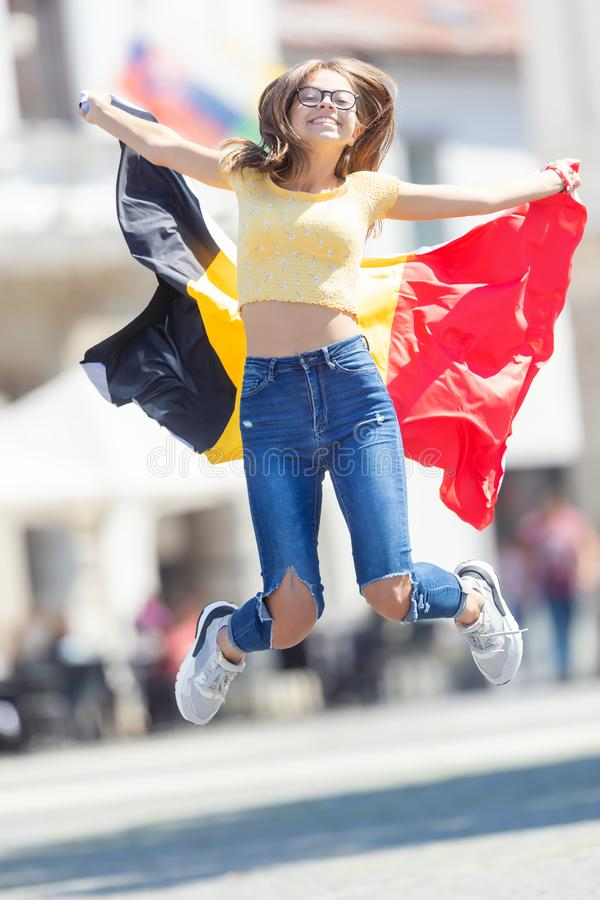 Young girl with the Belgian flag. Attractive happy young girl with the Belgian flag. Belgium, woman, female, beautiful, people, patriot, pretty, europe, union stock photo