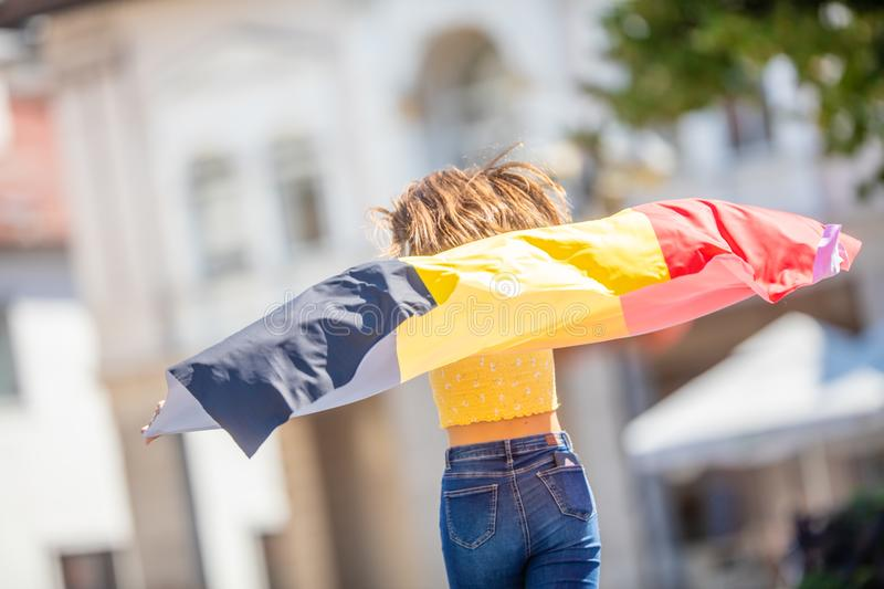 Attractive happy young girl with the Belgian flag royalty free stock images