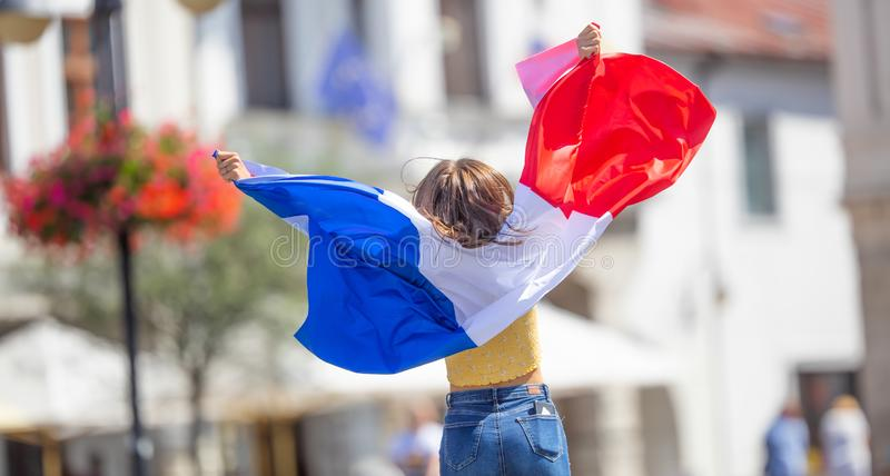 Attractive happy young girl with the Belgian flag stock photos