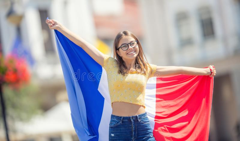 Attractive happy young girl with the Belgian flag. Attractive happy young girl with the France flag, french, woman, beautiful, europe, european, patriotism stock photography