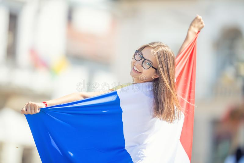 Attractive happy young girl with the Belgian flag. Attractive happy young girl with the France flag, french, woman, beautiful, europe, european, patriotism stock image