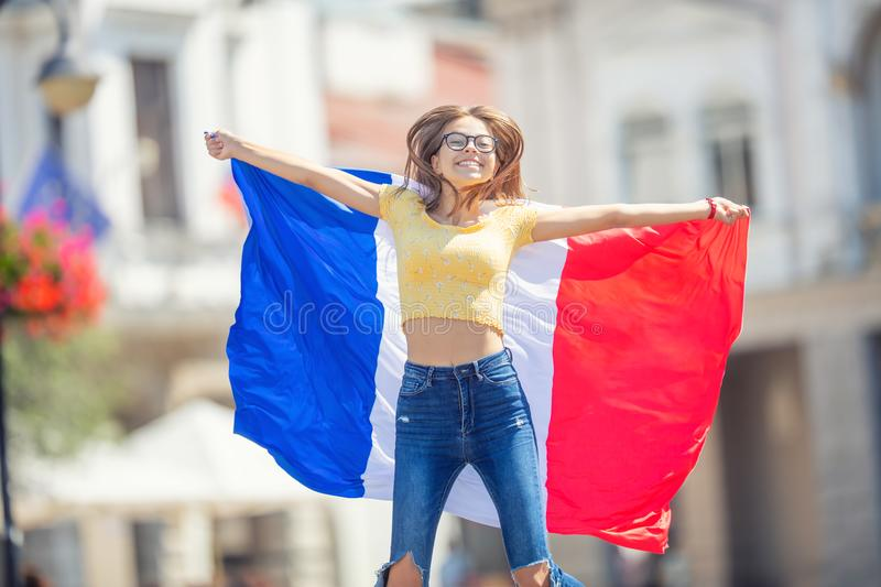 Attractive happy young girl with the Belgian flag royalty free stock image