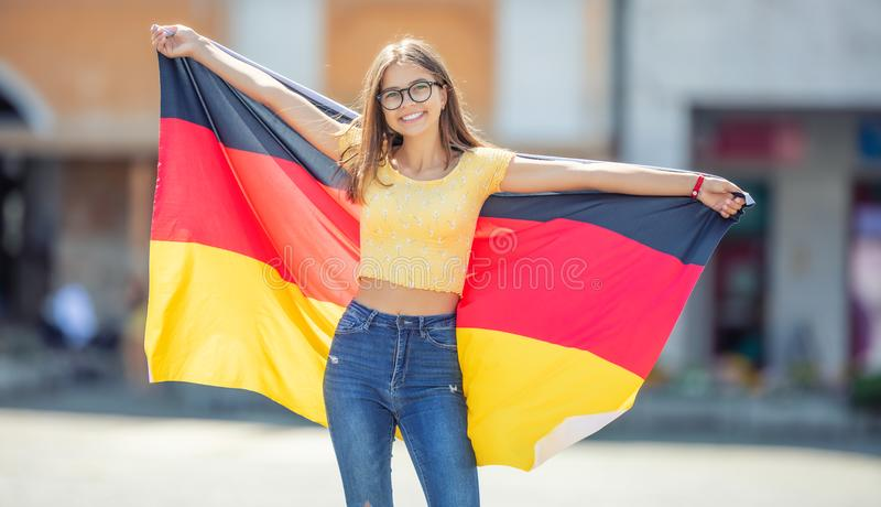 Attractive happy young girl with the germany flag. Person, people, female, european, woman, national, union, smile, travel, portrait, cheerful, fashion stock images