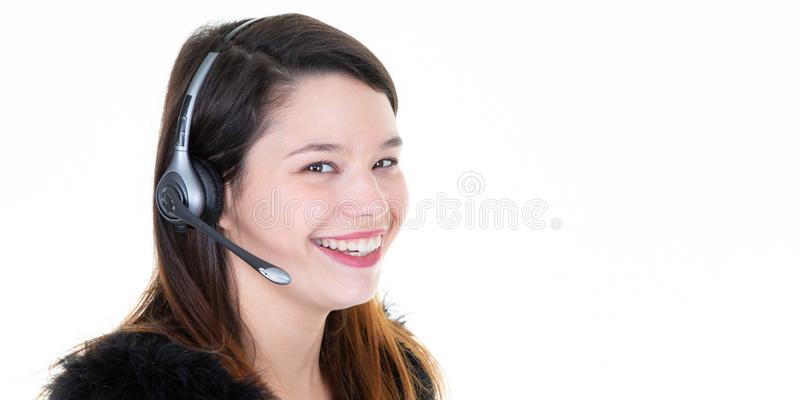 Attractive and happy young woman with headset on her head royalty free stock image