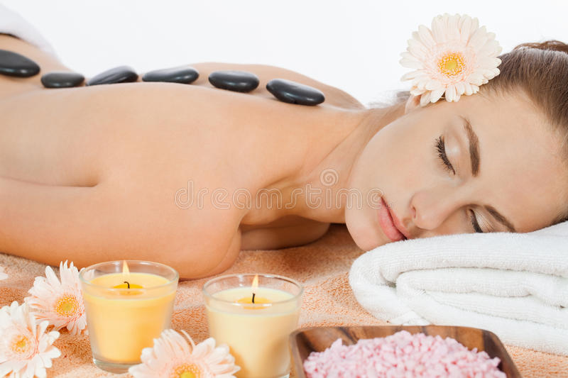 Attractive healthy caucasian woman hot stone massage wellness. Spa therapy stock photo