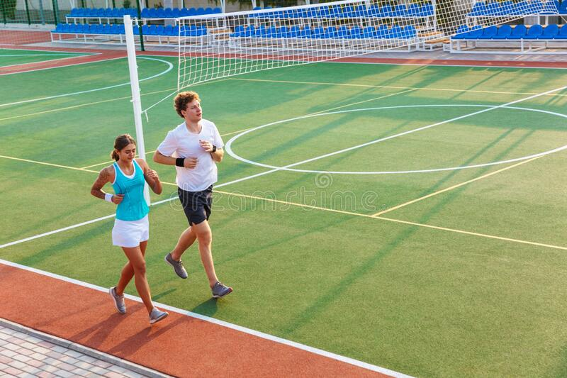 Attractive healthy fitness couple running royalty free stock photo