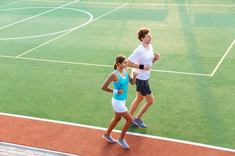 Attractive healthy fitness couple running royalty free stock images