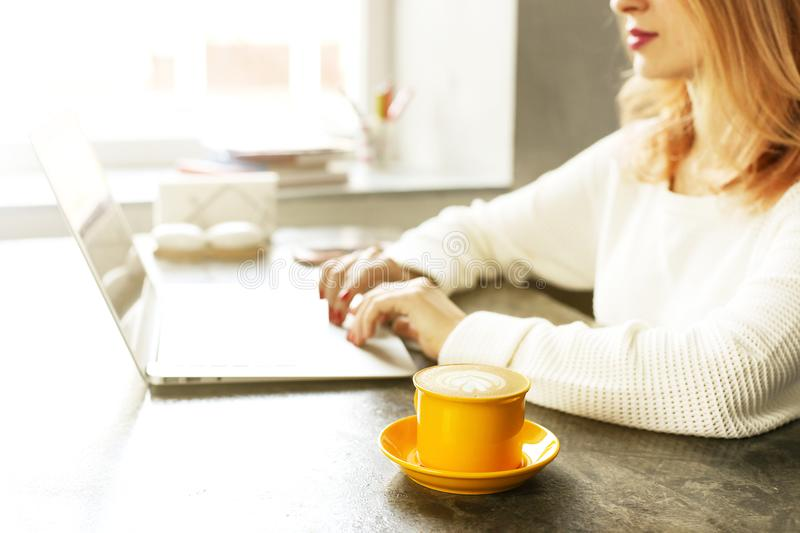 Attractive hipster young woman in modern loft cafe coffee shop restaurant. Writer, blogger, designer, freelancer, remote work proc royalty free stock photos
