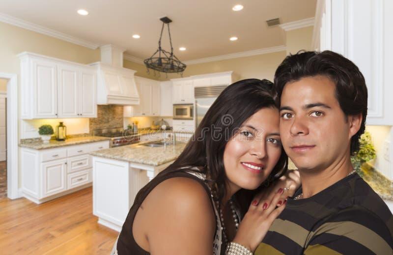 Attractive Hispanic Couple Inside Custom Kitchen Interior stock photos