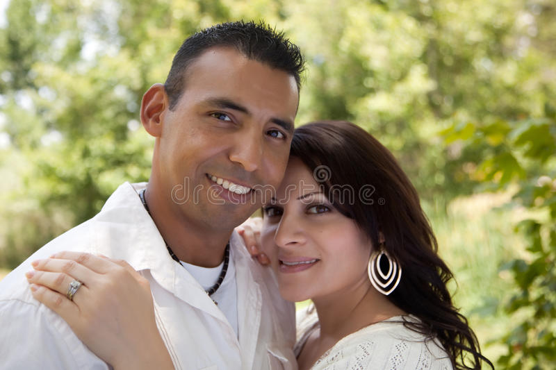 Download Attractive Hispanic Couple In The Park Stock Photo - Image of generation, daytime: 12269528