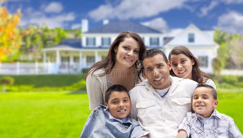 Attractive Hispanic Family in Front of Their New Home royalty free stock images