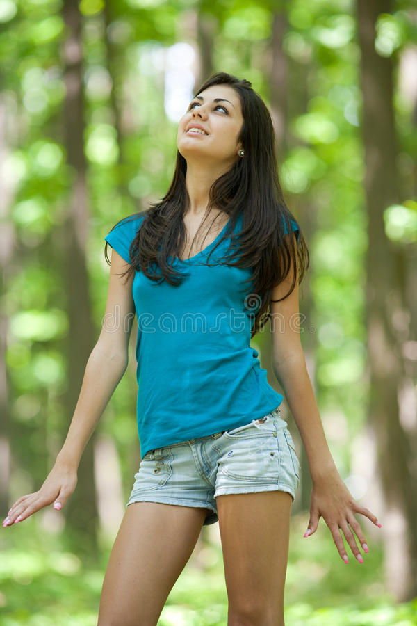 Attractive hispanic girl in the forest stock photography