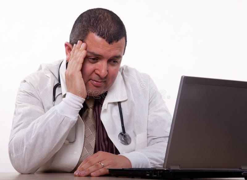 Attractive hispanic thirties male doctor headache stock photos
