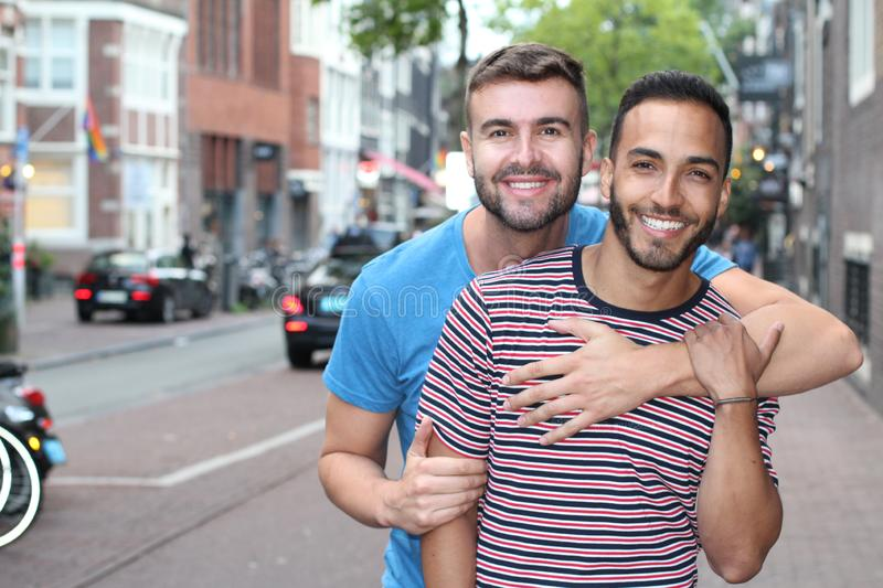 Attractive homosexual lovers smiling outdoors stock images