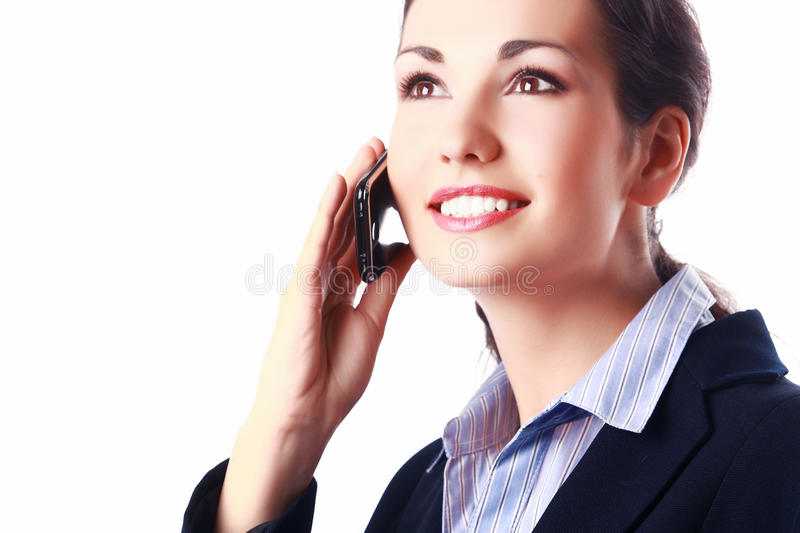Attractive inspired businesswoman with cellphone