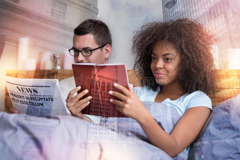 Attractive intelligent woman holding a book royalty free stock image