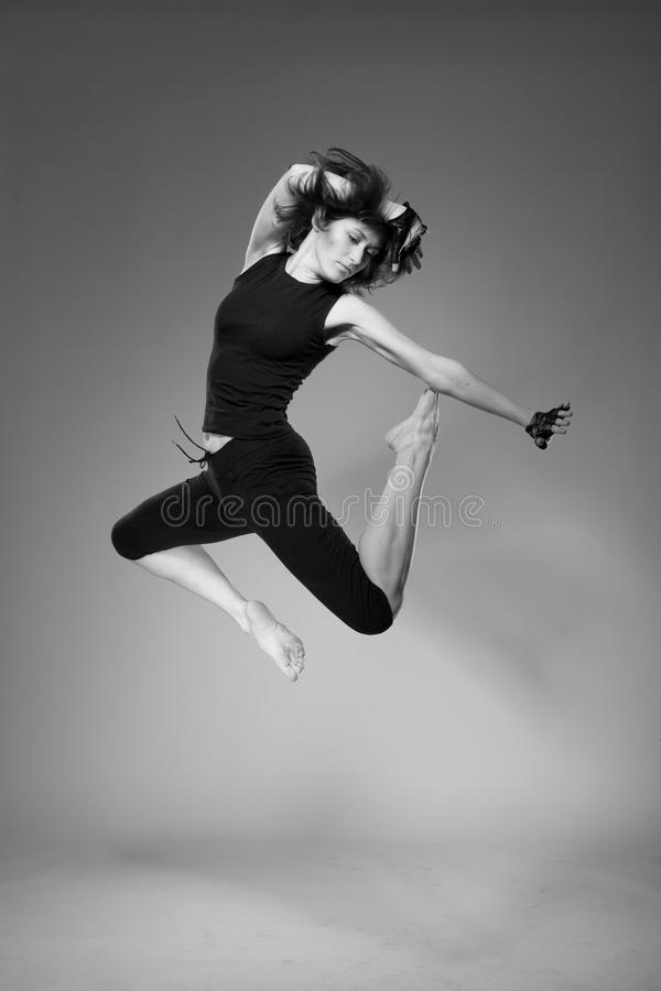 Attractive jumping woman stock images